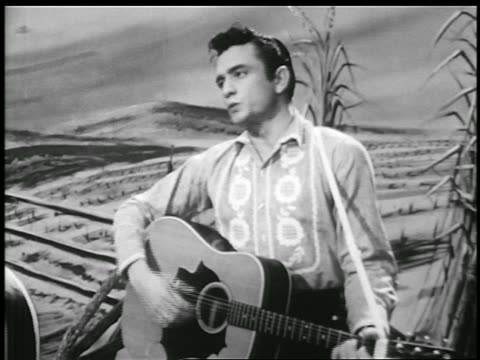 johnny cash playing guitar singing home of the blues / farm backdrop / music video - johnny cash stock videos & royalty-free footage