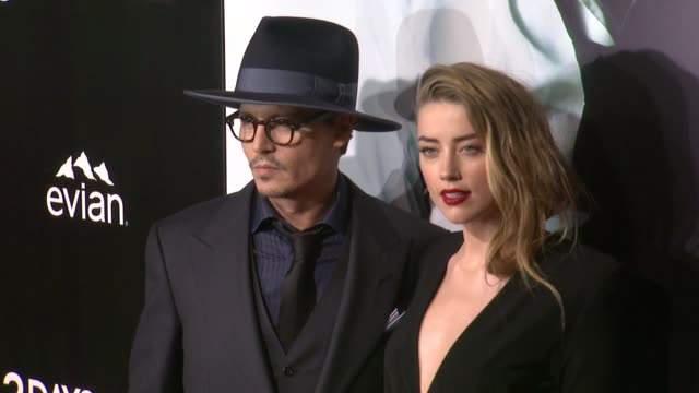 Johnny Depp and Amber Heard at 3 Days To Kill Los Angeles Premiere at ArcLight Cinemas on in Hollywood California