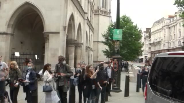 johnny depp and amber heard depart after attending the libel case between johnny depp and the sun newspaper at the royal courts of justice at royal... - libel stock videos & royalty-free footage