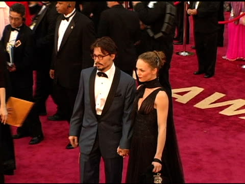 Johnny Depp and and Vanessa Paradis at the 2005 Annual Academy Awards Arrivals at the Kodak Theatre in Hollywood California on February 28 2005
