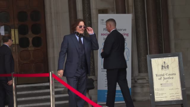 johnny depp arrives at the royal courts of justice strand on july 14 2020 in london england american actor johnny depp is taking news group... - royal courts of justice stock videos & royalty-free footage