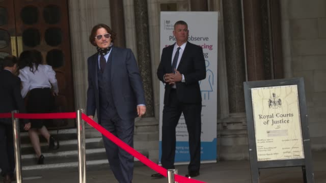 slomo johnny depp arrives at the royal courts of justice strand on july 14 2020 in london england american actor johnny depp is taking news group... - royal courts of justice stock videos & royalty-free footage
