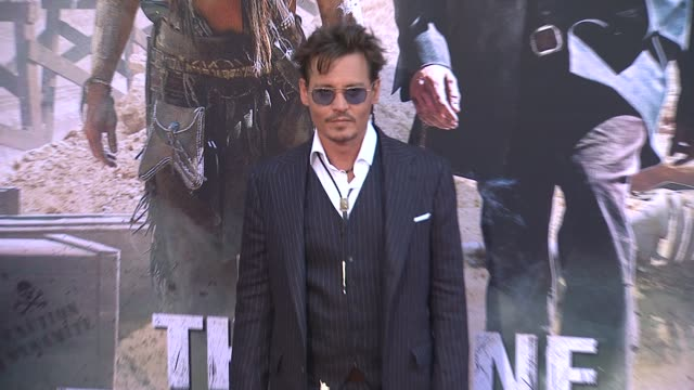 johnny depp at the lone ranger los angeles premiere johnny depp at the lone ranger los angeles premi at disney california adventure park on june 22... - the lone ranger 2013 film stock videos and b-roll footage