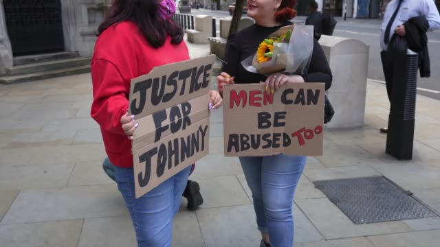 johnny depp fans wait outside the courts to show their support on the last day of the johnny depp vs the sun trial at royal courts of justice strand... - royal courts of justice stock videos & royalty-free footage