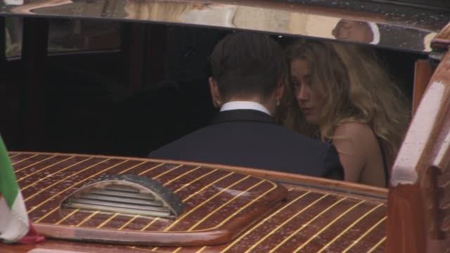 Johnny Depp kisses Amber Heard at Celebrity Sightings in Venice at on September 04 2015 in Venice Italy