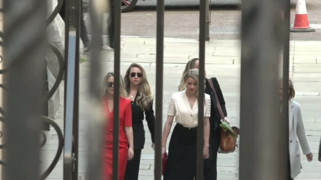 amber heard claims johnny depp explicitly threatened to kill her on several occasions england london ext amber heard along with entourage behind gates - news not politics stock videos & royalty-free footage