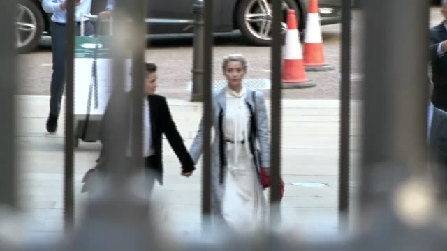 amber heard denies fabricating abuse allegations england london royal courts of justice ext amber heard and her partner bianca butti arriving together - amber heard stock videos & royalty-free footage