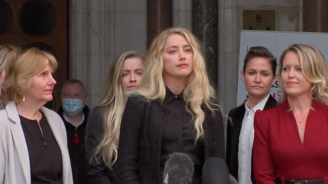 amber heard statement outside high court england london the strand royal courts of justice ext amber heard reading statement sot i travelled here to... - news not politics stock videos & royalty-free footage