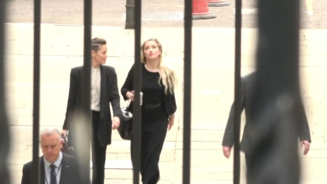 amber heard's sister gives evidence england london royal courts of justice ext johnny depp waving and holding sunflowers as entering court amber... - news not politics stock videos & royalty-free footage