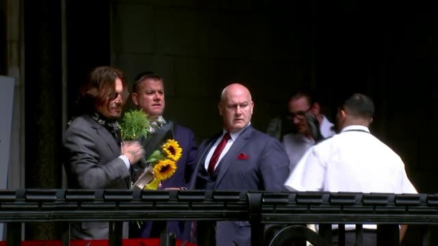 amber heard's sister gives evidence england london royal courts of justice ext johnny depp waving and holding sunflowers as entering court - news not politics stock videos & royalty-free footage