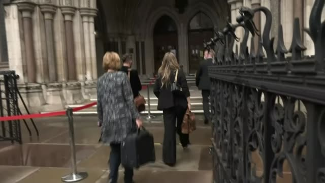 johnny depp libel trial continues england london aldwych royal courts of justice amber heard wearing face covering along towards past press and... - amber heard stock videos & royalty-free footage