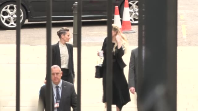 court arrivals england london royal courts of justice ext van arriving / amber heard along from van to court / - news not politics stock videos & royalty-free footage
