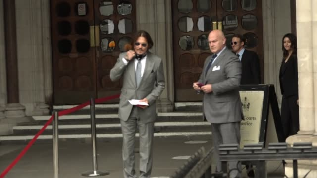 johnny depp and amber heard court arrivals england london strand royal courts of justice ext johnny depp arriving and along through fans and press /... - news not politics stock videos & royalty-free footage