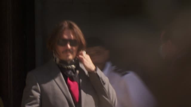 johnny depp and amber heard court arrivals england london the strand royal courts of justice ext johnny depp arriving in car along through press and... - news not politics stock videos & royalty-free footage