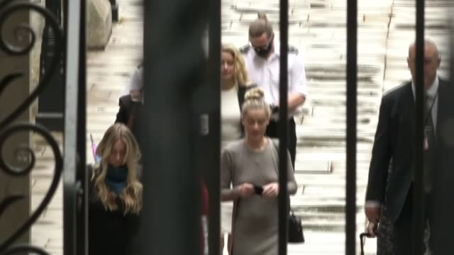 lawyers for the sun give closing arguments england london the strand royal courts of justice ext long shot amber heard arriving at court - news not politics stock videos & royalty-free footage