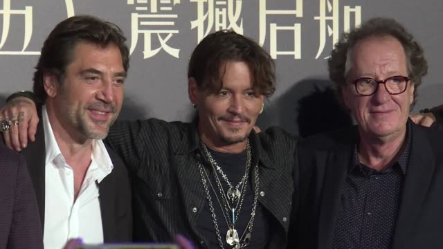 """Johnny Depp Orlando Bloom and Javier Bardem speak at a press conference following the world premiere of the latest """"Pirates of the Caribbean"""" film in..."""