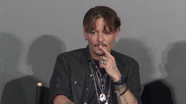 johnny depp reaches a settlement with his former business managers allowing the oscar nominated american actor to avoid a trial over his finances... - johnny depp stock videos and b-roll footage