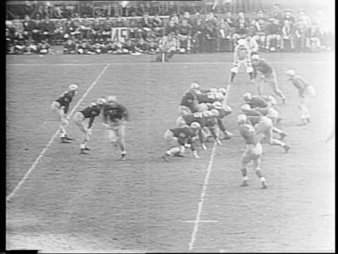johnny lujack makes second touch down for notre dame / doug kenna attempts a pass for army but it is intercepted by notre dame / closeup of cadets... - touch football video stock e b–roll