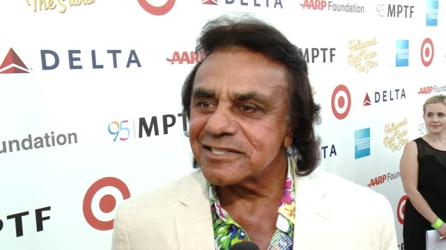 INTERVIEW Johnny Mathis on singing a song from West Side story on his singing career at the George Clooney Hosts MPTF's 95th Anniversary Celebration...