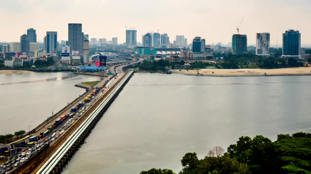 johor–singapore causeway in timelapse - straits stock videos and b-roll footage