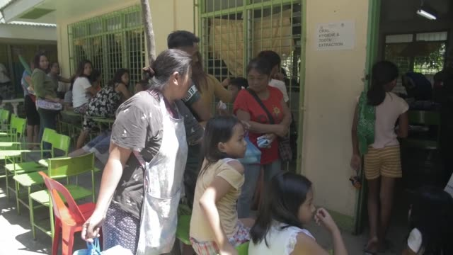 joint armed forces from the philippines australia and us conduct a community health engagement at pagasa elementary school in orani bataan... - soziales thema stock-videos und b-roll-filmmaterial
