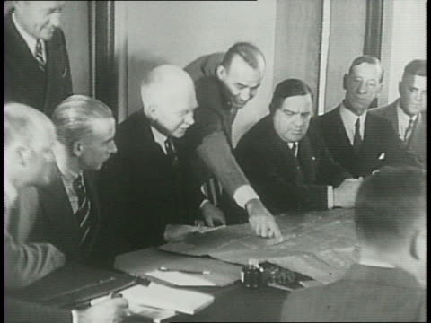 Joint Defense Committee of the United States and Canada sitting around boardroom table / Mayor Fiorello La Guardia of New York / Canadian Colonel...