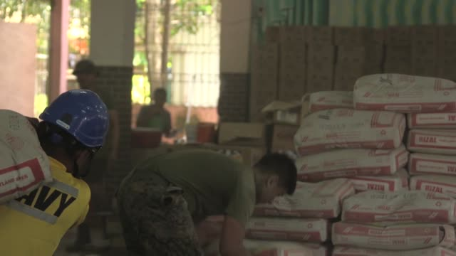 joint forces from the philippines australia and us work on a construction project during balikatan 2019 at the victor o' de guia jr memorial... - guia stock videos & royalty-free footage