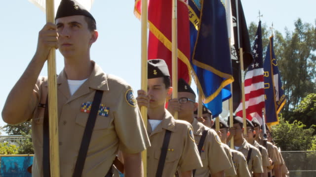 joint jrotc honor guard prepares to post the colors during the miami beach veterans day ceremony on november 11, 2014 in miami beach, florida. no... - veterans day stock videos & royalty-free footage