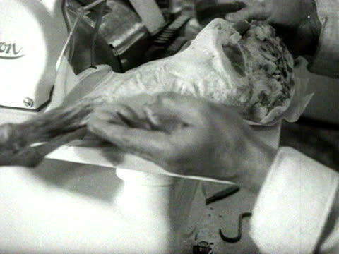 a joint of meat is placed onto weighting scales in a butchers shop 1954 - butcher stock videos & royalty-free footage