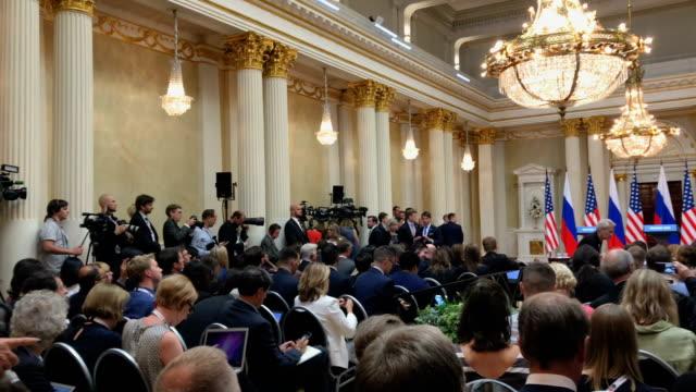 a joint press conference after their summit between president donald trump and russian president vladimir putin on july 16 2018 in helsinki finland... - g8:s toppmöte bildbanksvideor och videomaterial från bakom kulisserna