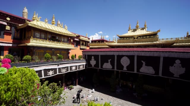 jokhang temple is one of the holiest sites of tibetan buddhism and with the well preserved tibetan architectures listed on unesco world cultural... - golden roof stock videos and b-roll footage