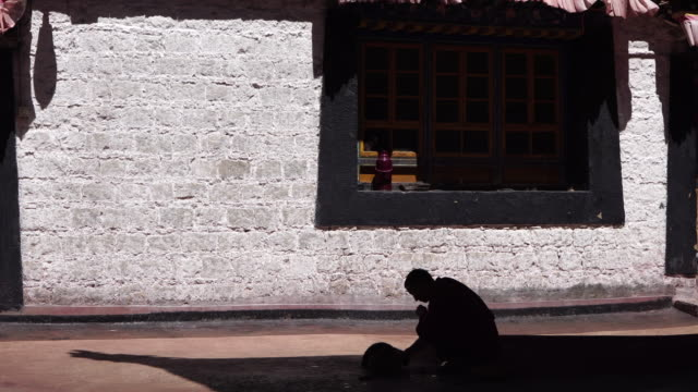 jokhang temple one of the holiest sites of tibetan buddhism and listed on unesco world cultural heritage - monk stock videos and b-roll footage