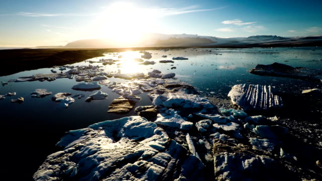 aerial: jokulsarlon glacier lake at sunset, iceland - arctic stock videos & royalty-free footage