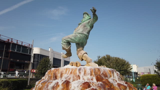 jolly fisherman statue at the seaside holiday resort of skegness in lincolnshire england. - jolly video stock e b–roll
