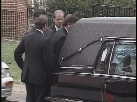 jon benet ramsey's casket being loaded into a hearse at her funeral. - boulder stock videos & royalty-free footage