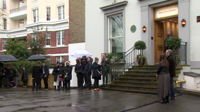 jon bon jovi stood in doorway of abbey road studios walks down stairs to await prince harry arrival to record charity single for invictus games - steps stock videos & royalty-free footage