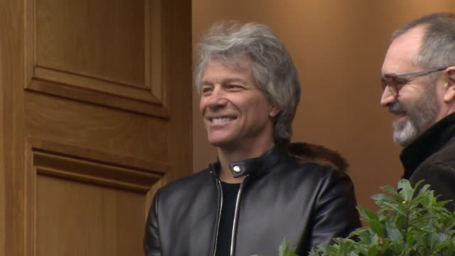 jon bon jovi waiting in doorway of abbey road studios waiting for prince harry to arrive to record invictus games charity single he waves and smiles... - doorway stock videos & royalty-free footage