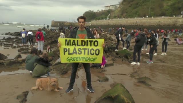 jon kortajarena and greenpeace gather plastic at the ereaga beach - greenpeace stock videos & royalty-free footage