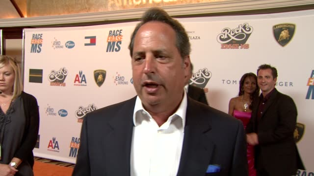 vídeos de stock e filmes b-roll de jon lovitz on being a part of the night, what he's most looking forward to at the 16th annual race to erase themed 'rock to erase at los angeles ca. - race to erase ms