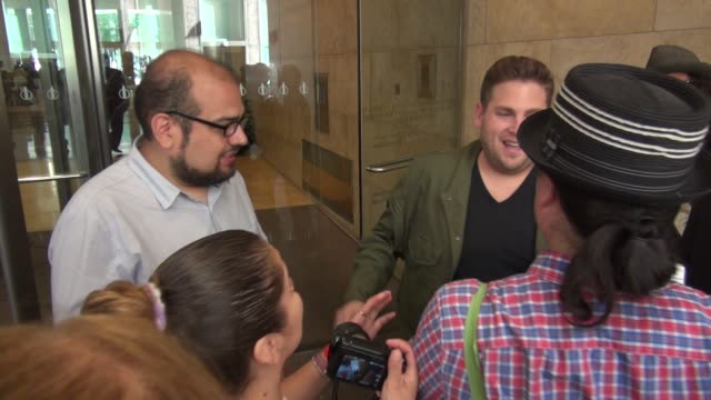 Jonah Hill exits SiriusXM Satellite Radio poses with signs for fans before getting into his car in Celebrity Sightings in New York