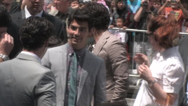 jonas brothers at el capitan theatre in hollywood at the celebrity sightings in los angeles at los angeles ca. - el capitan theatre stock videos & royalty-free footage