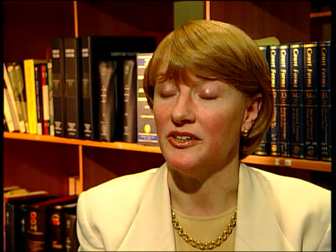 jonathan aitken trial; jonathan aitken trial; itn england: london: int geraldine proudler looking at books on shelf and interview sot - most... - crime or recreational drug or prison or legal trial stock-videos und b-roll-filmmaterial