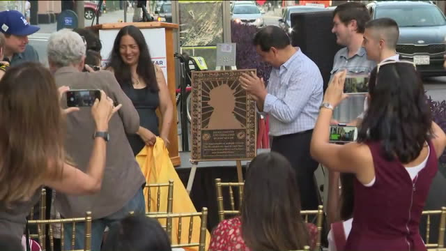 jonathan gold plaque, light posts unveiled at grand central market in honor of late food critic. - critic stock videos & royalty-free footage