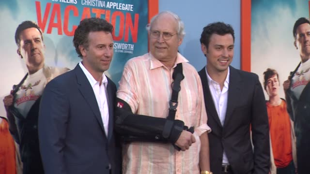 jonathan goldstein john francis daley and chevy chase at the vacation los angeles premiere at regency village theatre on july 27 2015 in westwood... - regency village theater stock videos and b-roll footage