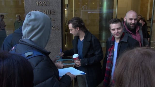 jonathan jackson with richard lee jackson signs for fans while departing from the siriusxm satellite radio studio on november 03, 2014 in new york... - avvistamenti vip video stock e b–roll