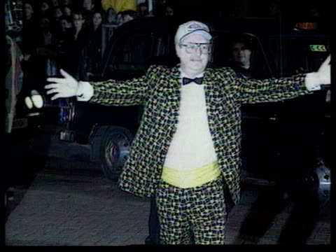 jonathan king released from prison date jonathan king towards camera with arms outstretched in garish suit and baseball cap - arms outstretched stock videos and b-roll footage