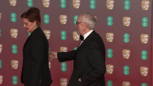 jonathan pryce and wife kate fahy on red carpet at bafta film awards 2020 - ジョナサン・プライス点の映像素材/bロール