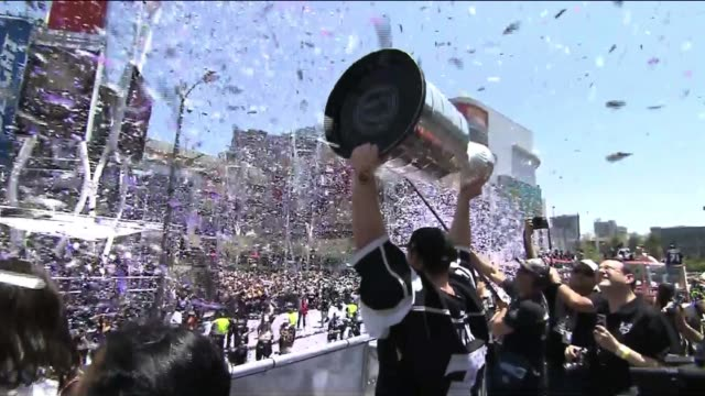 Jonathan Quick Holds Stanley Cup to Parade Onlookers
