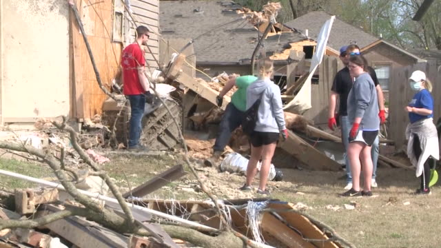 wreg jonesboro ar us people cleaning up mass damages after tornado on saturday march 29 2020 - blowhole stock videos & royalty-free footage