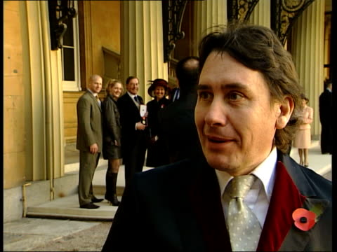 jools holland and dave glimour receive honors; england, london, clarence house jools holland towards; holland intvw on receiving obe; holland... - jools holland stock-videos und b-roll-filmmaterial